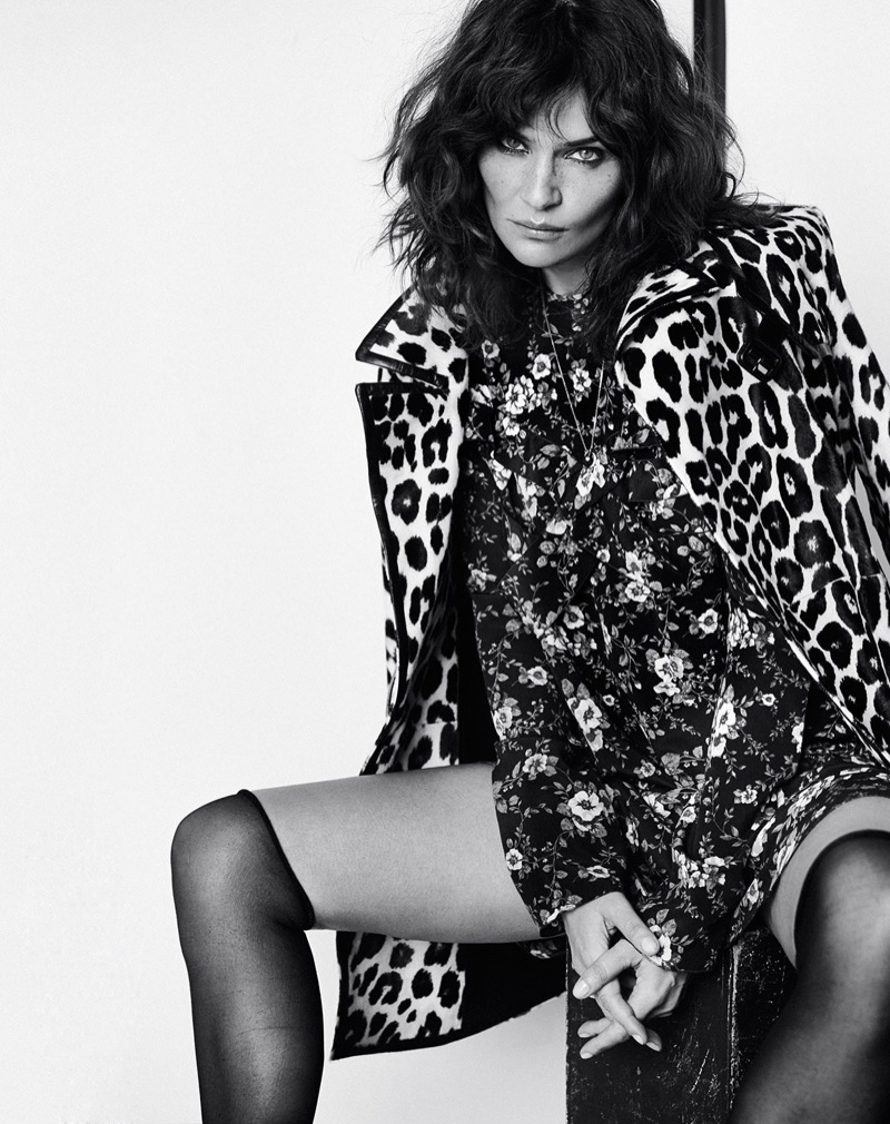 Helena Christensen poses in leopard print coat with floral dress and stockings