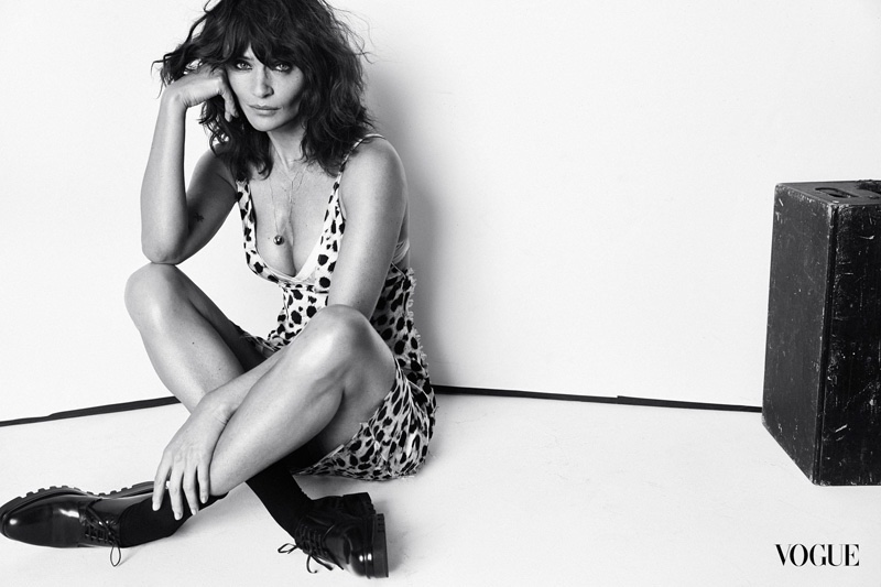 A spotted print and menswear inspired shoes are worn by Helena Christensen