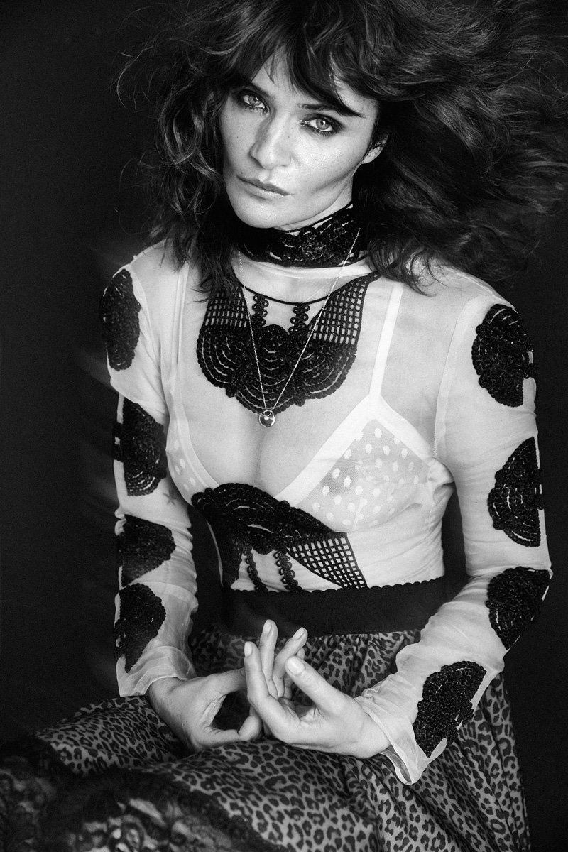 Helena Christensen models embroidered top and leopard print skirt