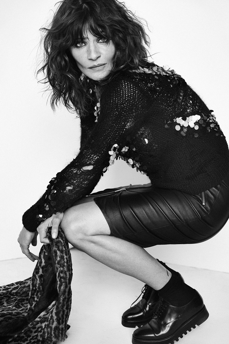Shot in black and white, Helena Christensen wears embellished top and leather skirt look