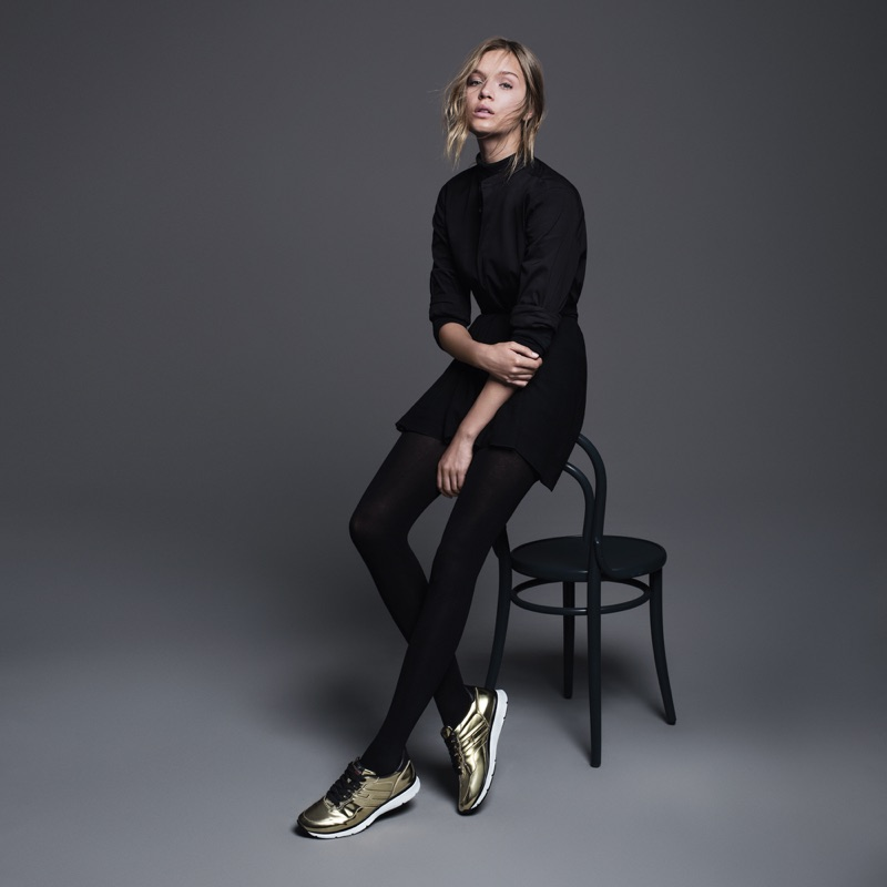 Josephine Skriver wears metallic gold sneakers for Hogan's fall-winter 2016 campaign.