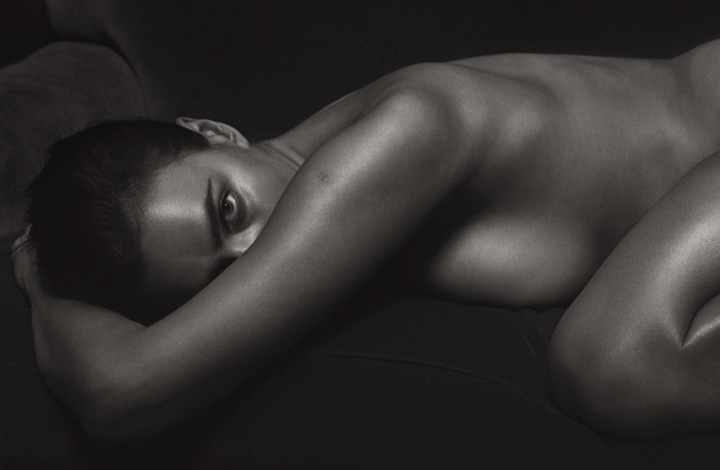 Irina Shayk goes topless in this black and white photograph