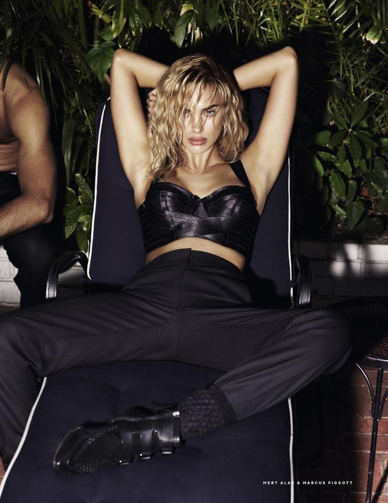Irina Shayk poses in black bustier and high-waist pants