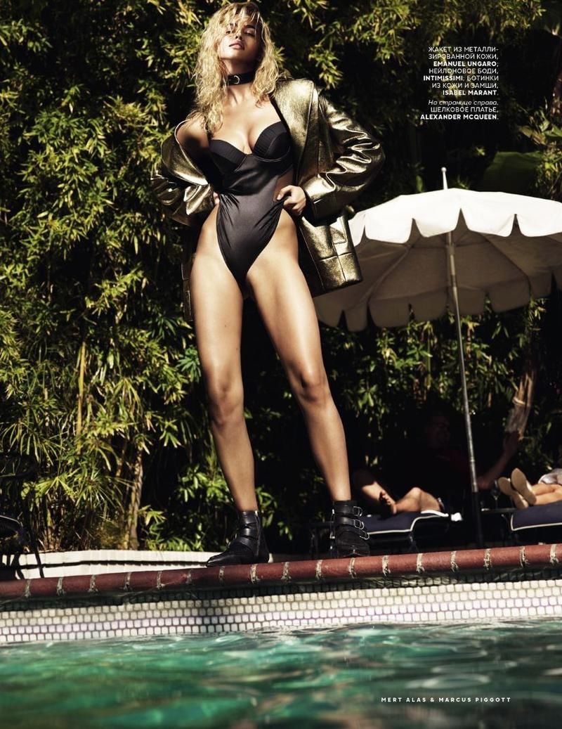 Irina Shayk poses poolside in Isabel Marant and Emanuel Ungaro
