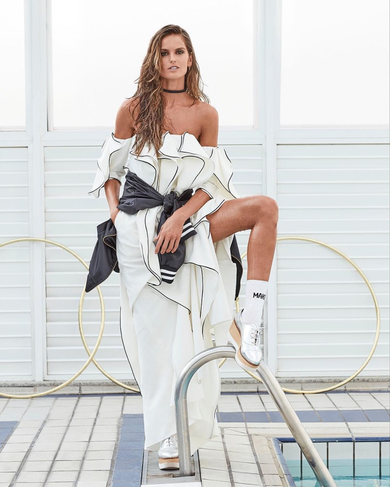 Izabel Goulart flaunts some skin in folded dress with high fashion sneakers