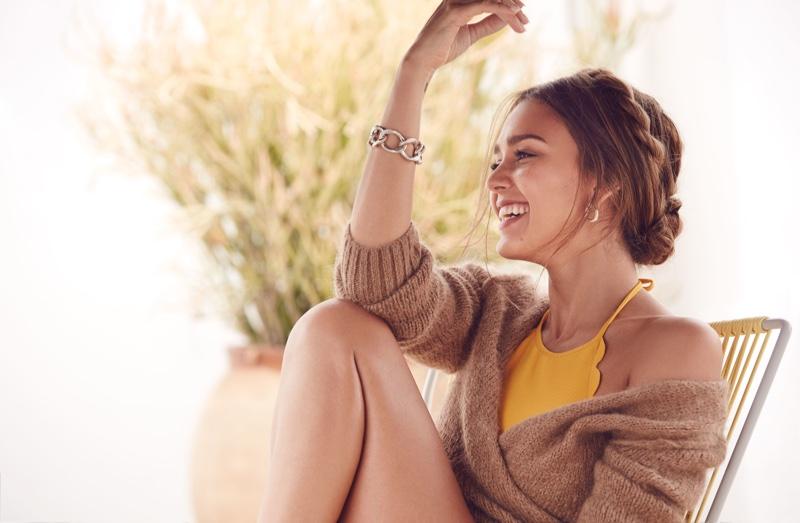 Jessica Alba wears A Détacher sweater with Marysia bikini top