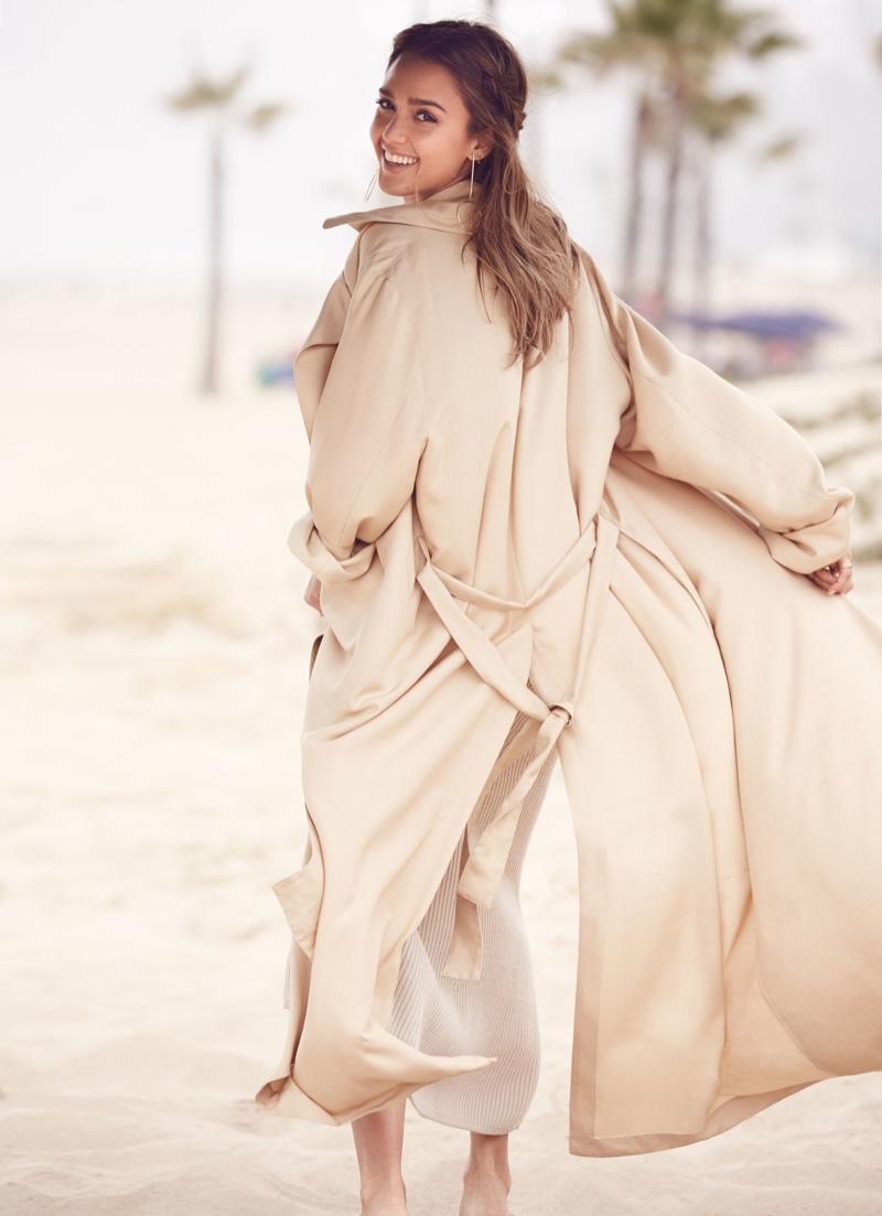 Jessica Alba wears The Row coat, Pringle of Scotland dress and H&M earrings
