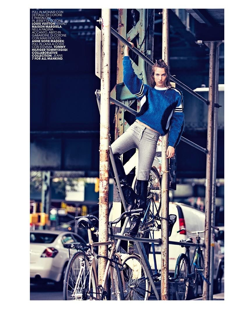 Jessica Miller poses in mohair/cotton sweater and pants by Louis Vuitton with Maison Margiela boots