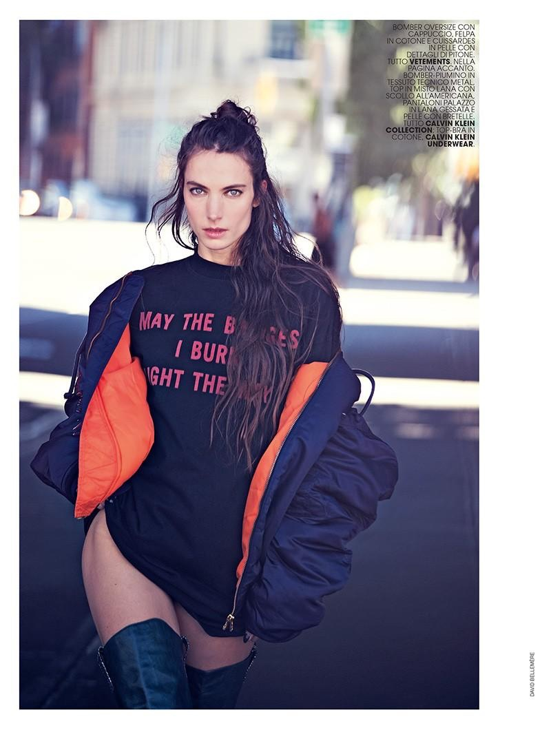 Jessica Miller poses in bomber jacket, cotton tee and leather boots from Vetements