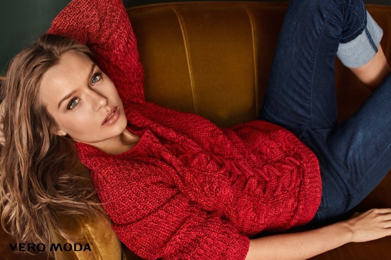 Josephine Skriver lounges in cable knit sweater and denim from Vero Moda