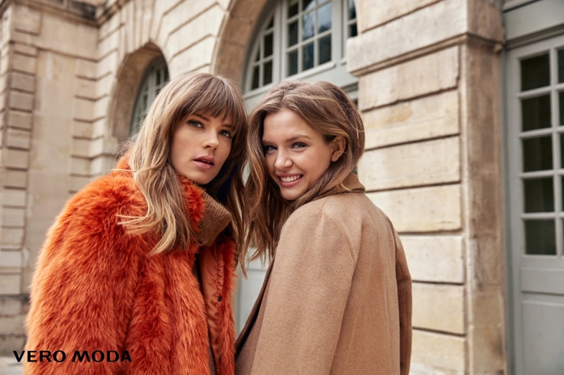 Caroline poses in colored faux fur while Josephine models tan coat from Vero Moda