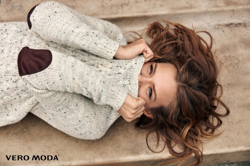 Josephine Skriver covers up in Vero Moda marbled sweater with patched sleeves