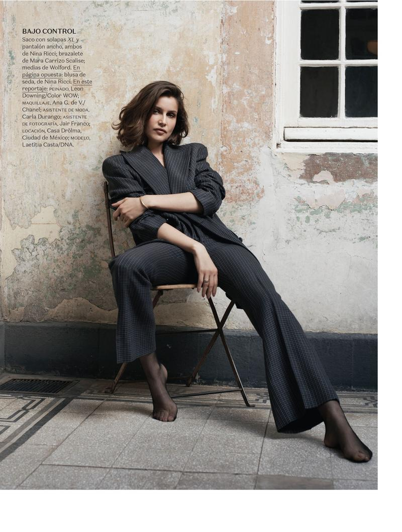 Laetitia Casta suits up in Nina Ricci pinstriped jacket and pants