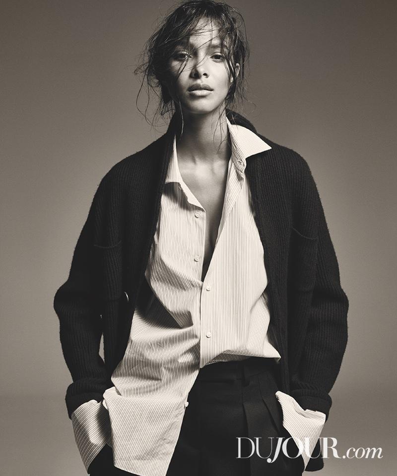 Lais Ribeiro wears Brunello Cucinelli cardigan, Isaia shirt and DKNY pants
