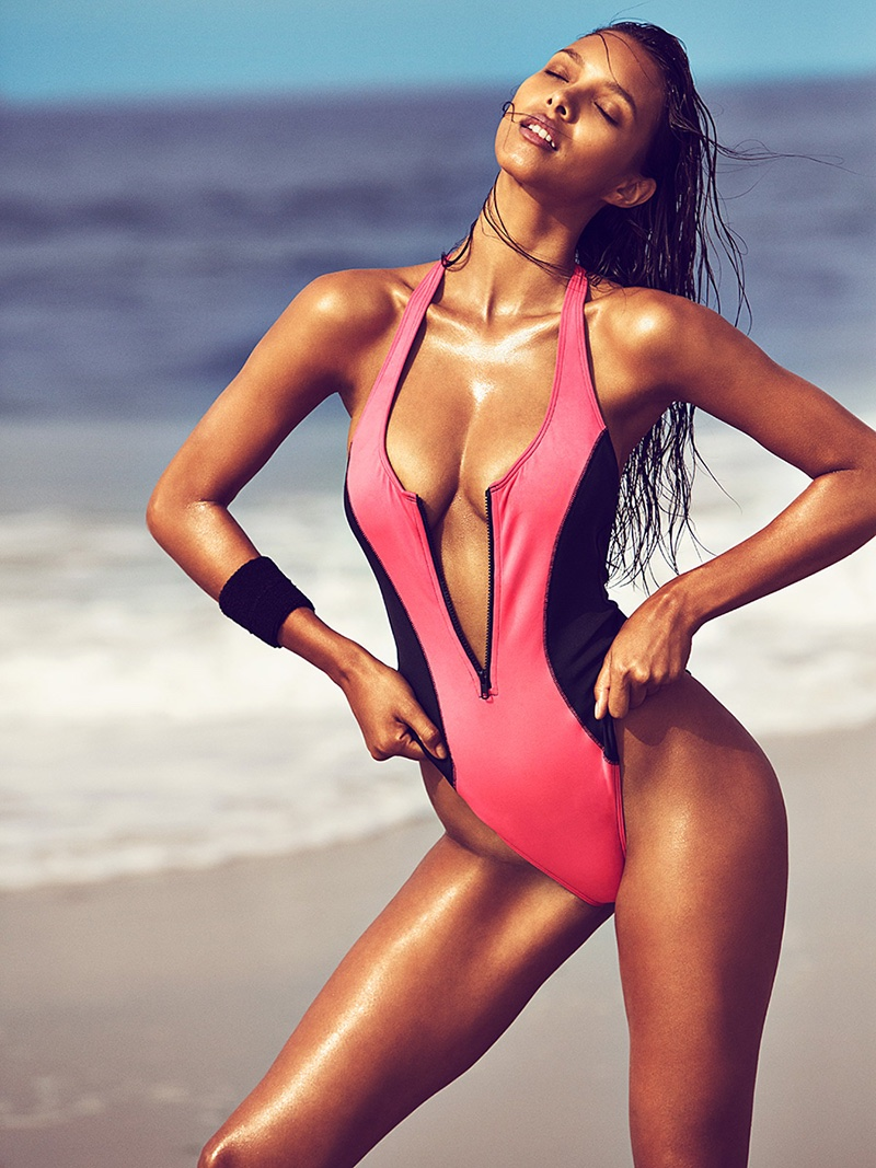 Lais Ribeiro models pink one-piece swimsuit with plunging neckline