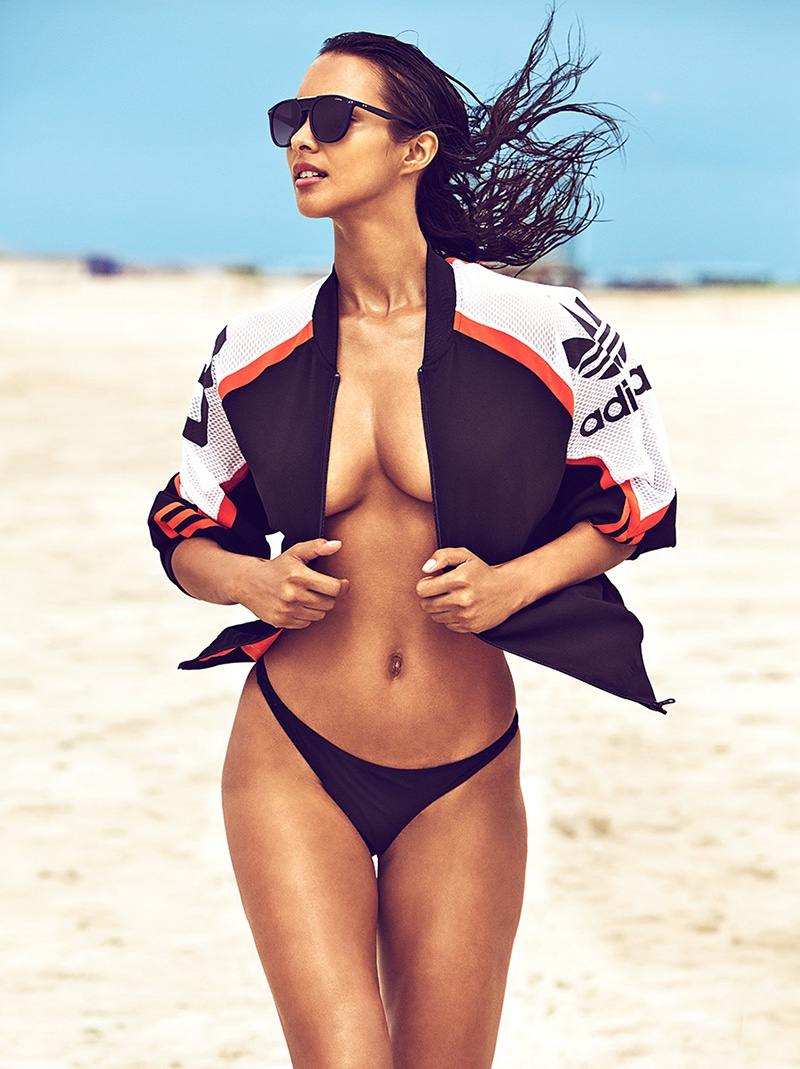 Lais Ribeiro hits the sand in adidas jacket, Polaroid sunglasses and Victoria's Secret bikini bottom