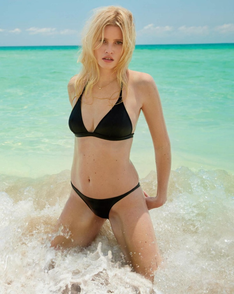 Lara Stone takes to the beach in an Eres swimsuit.