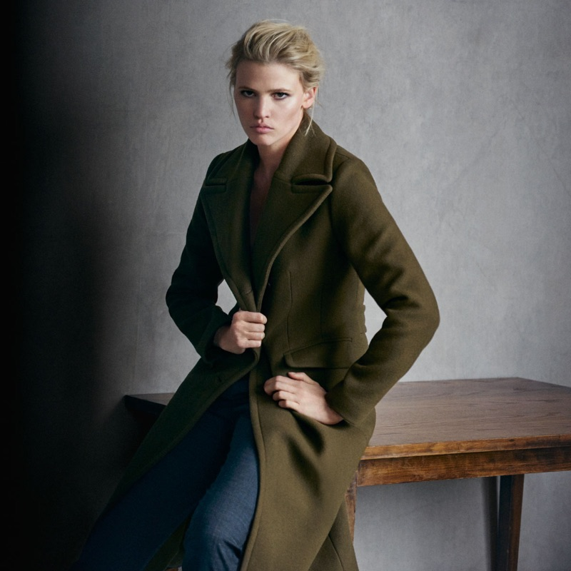 Lara Stone embraces tomboy style in an army green coat for Marc O'Polo's fall-winter 2016 campaign.