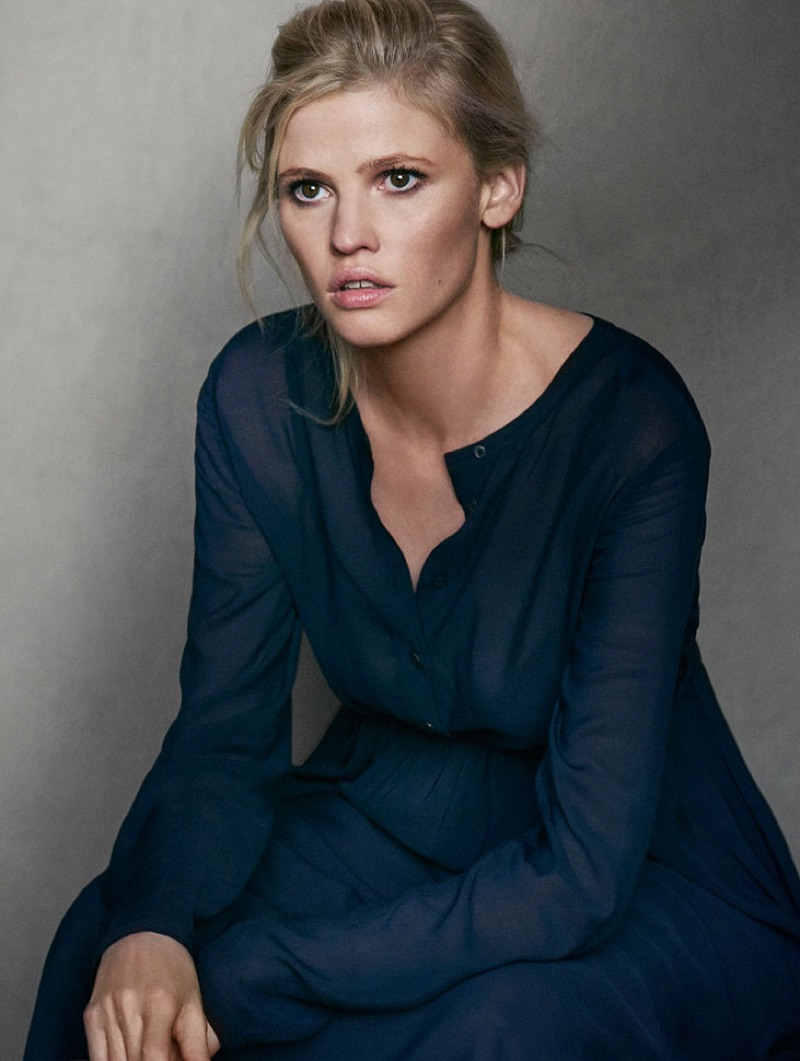Lara Stone is pictured in an understated navy dress for Marc O'Polo's fall-winter 2016 campaign.