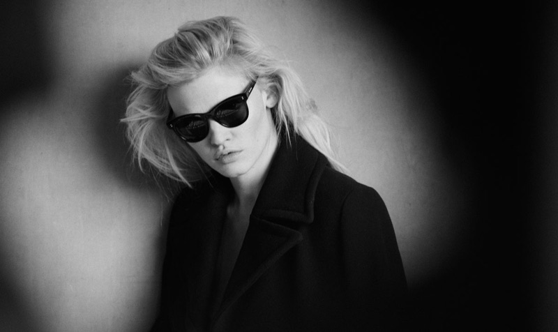 Lara Stone is a cool vision in black shades as she is captured behind the scenes of her new campaign for Marc O'Polo.