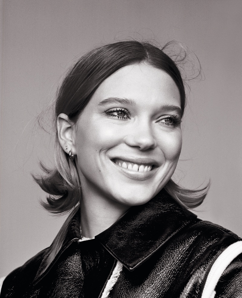 Lea Seydoux is all smiles with a flipped hairstyle