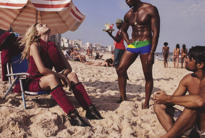 Lily Donaldson hits the beach in Chanel scarf, dress, boots and bag