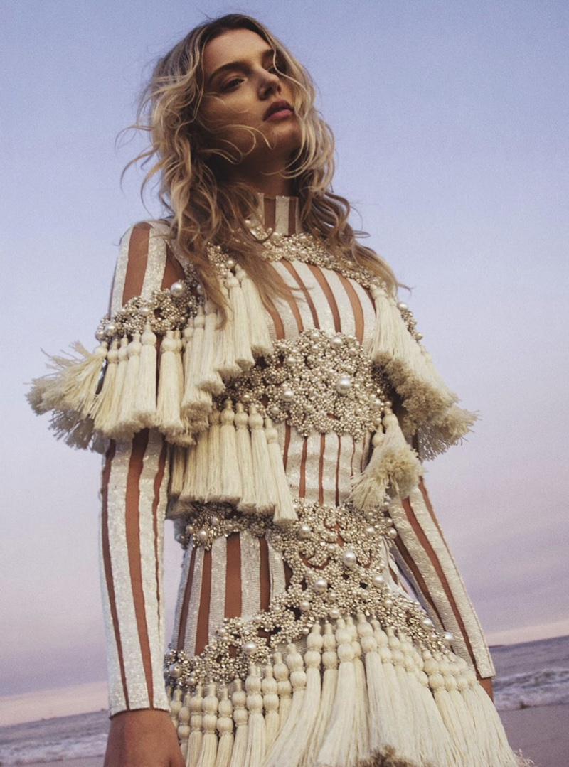 The model wears shimmering fringe dress from Balmain
