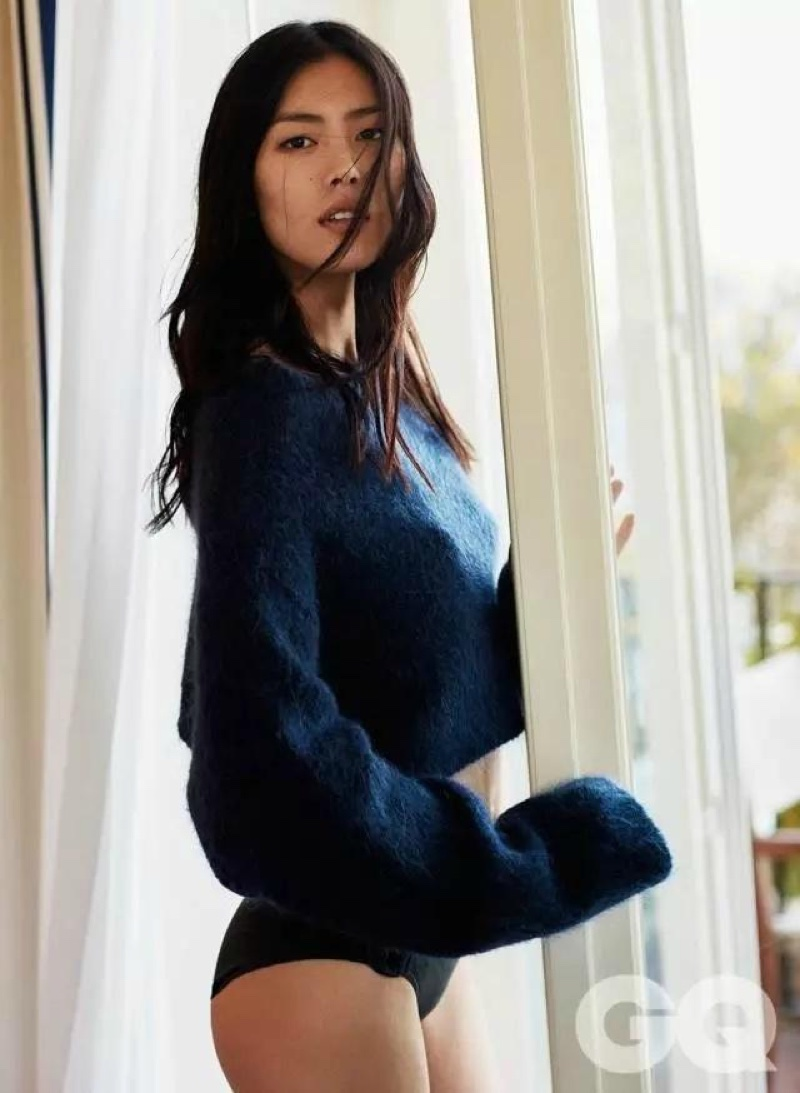 Liu Wen models blue sweater and black briefs