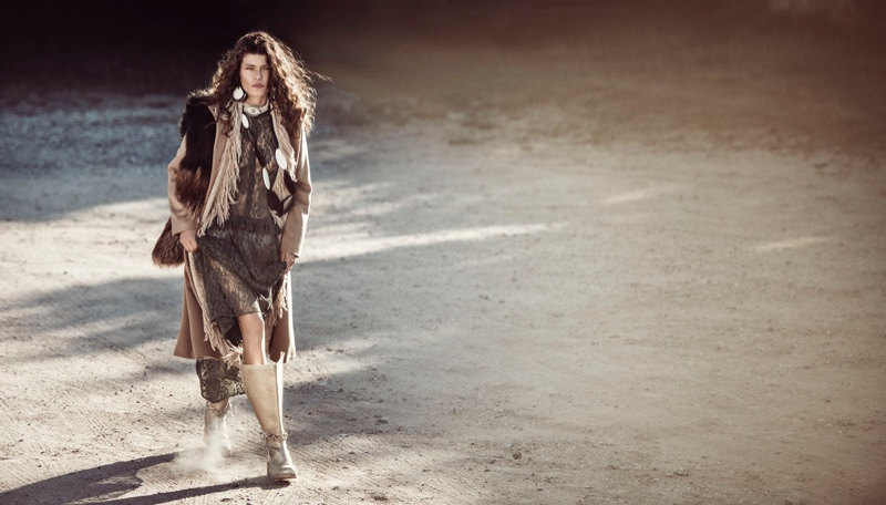 Louise Pedersen layers up in bohemian inspired look with tan boots