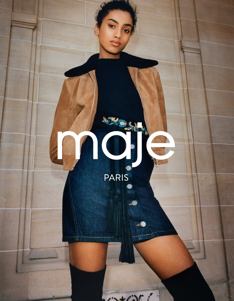 Maje's fall 2016 campaign features model Imaan Hammam wearing cropped jacket, black shirt and denim mid-length skirt