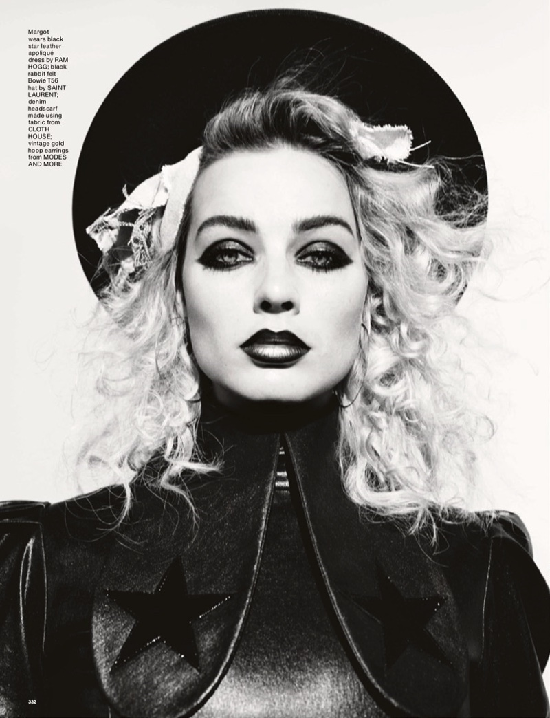 Margot Robbie wears leather look with her hair in 1980's inspired waves