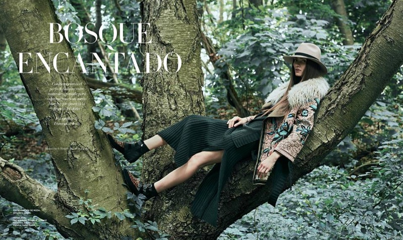 Marine Deleeuw poses in the forest for the fashion editorial