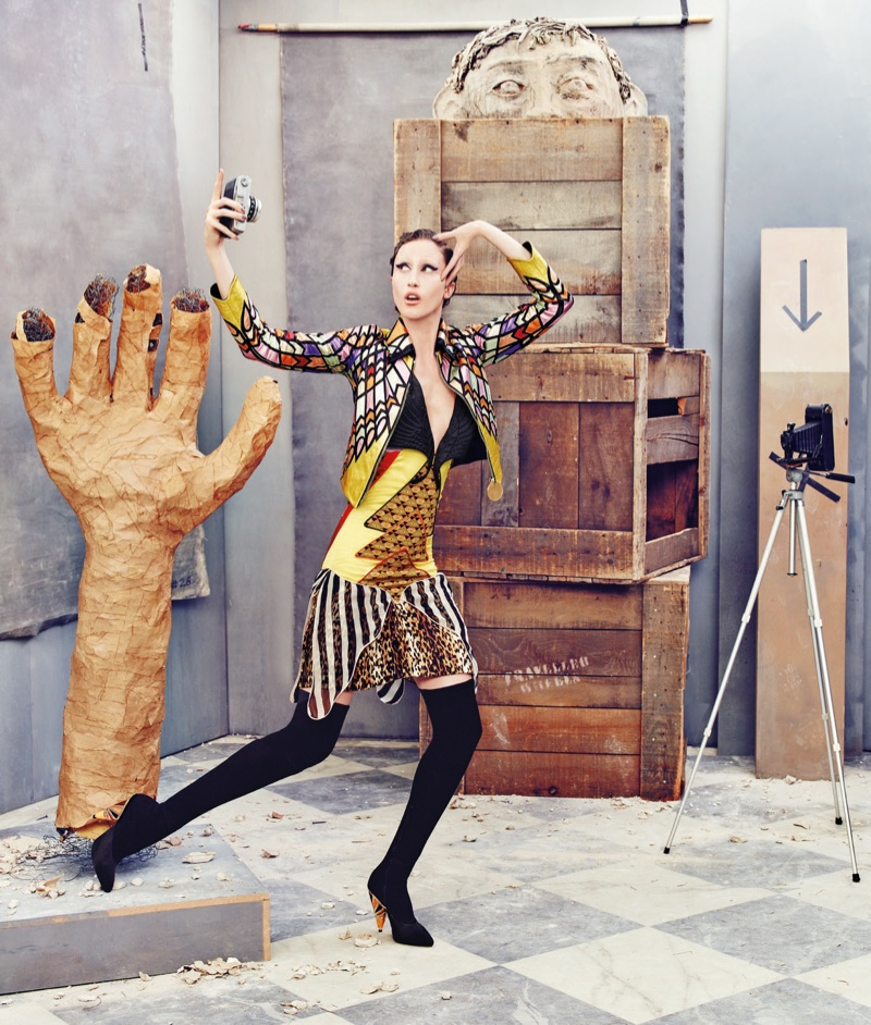Anna Cleveland models Givenchy cropped jacket, dress and boots in Neiman Marcus' Art of Fashion campaign