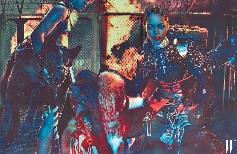 Rihanna serves punk attitude in Prada jacket, corsets, chains, bag, furs and boots