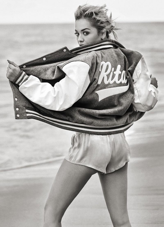 Rita Ora wears varsity jacket with shorts