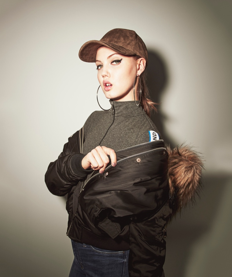Lindsey Wixson wears baseball cap with bomber jacket from River Island's fall 2016 collection