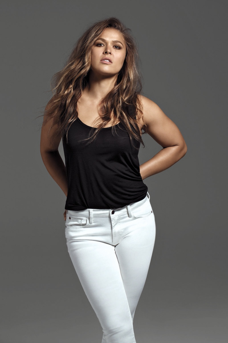 Ronda Rousey poses in white jeans from Buffalo Jeans