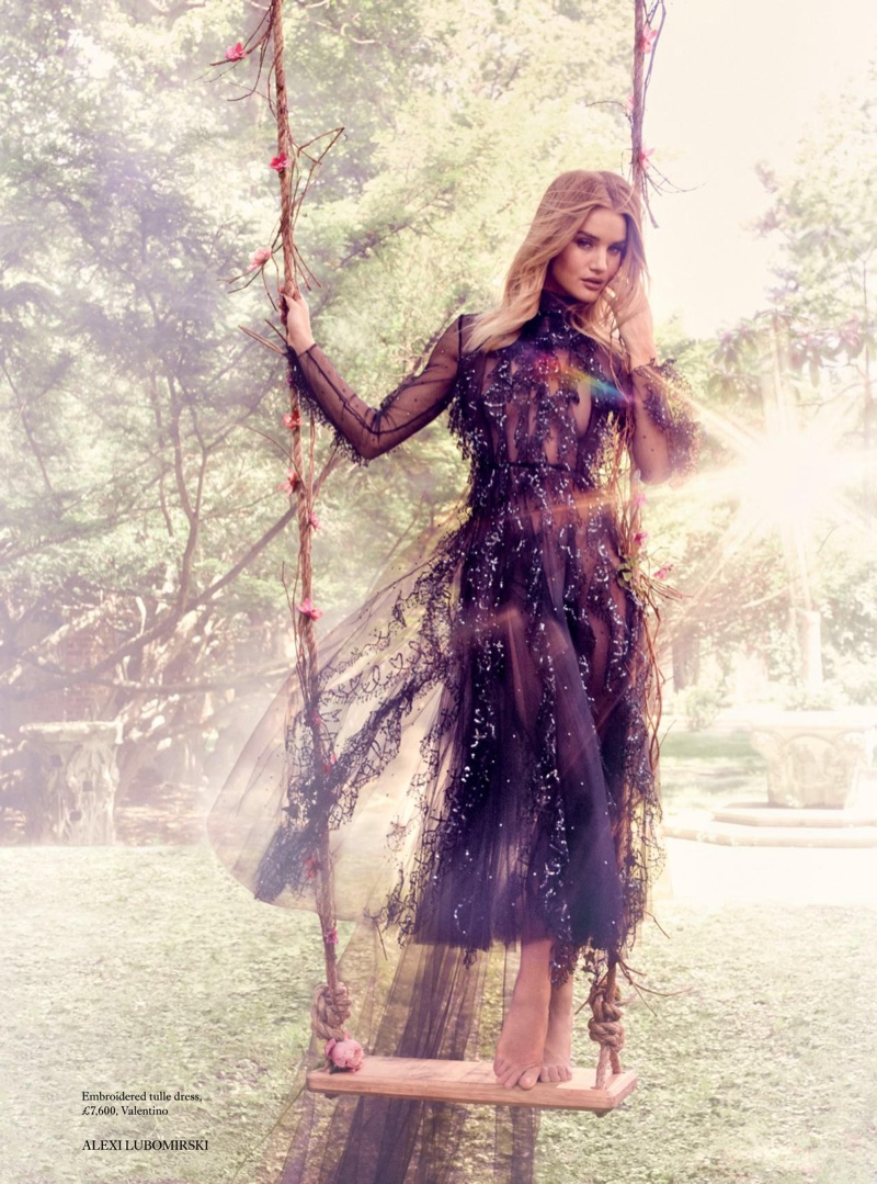 Posing on a swing, Rosie Huntington-Whiteley wears embroidered tulle dress from Valentino