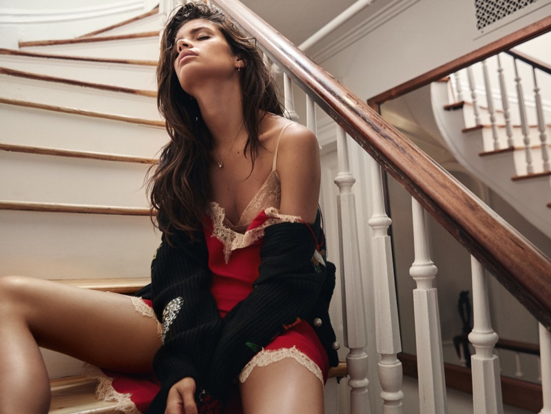 Posing on the stairs, Sara Sampaio models cardigan and slip dress by Gucci