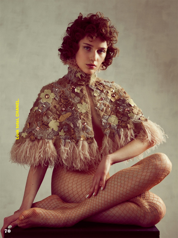 Sofia Tesmenitskaya poses in Chanel embroidered capelet and fishnet stockings