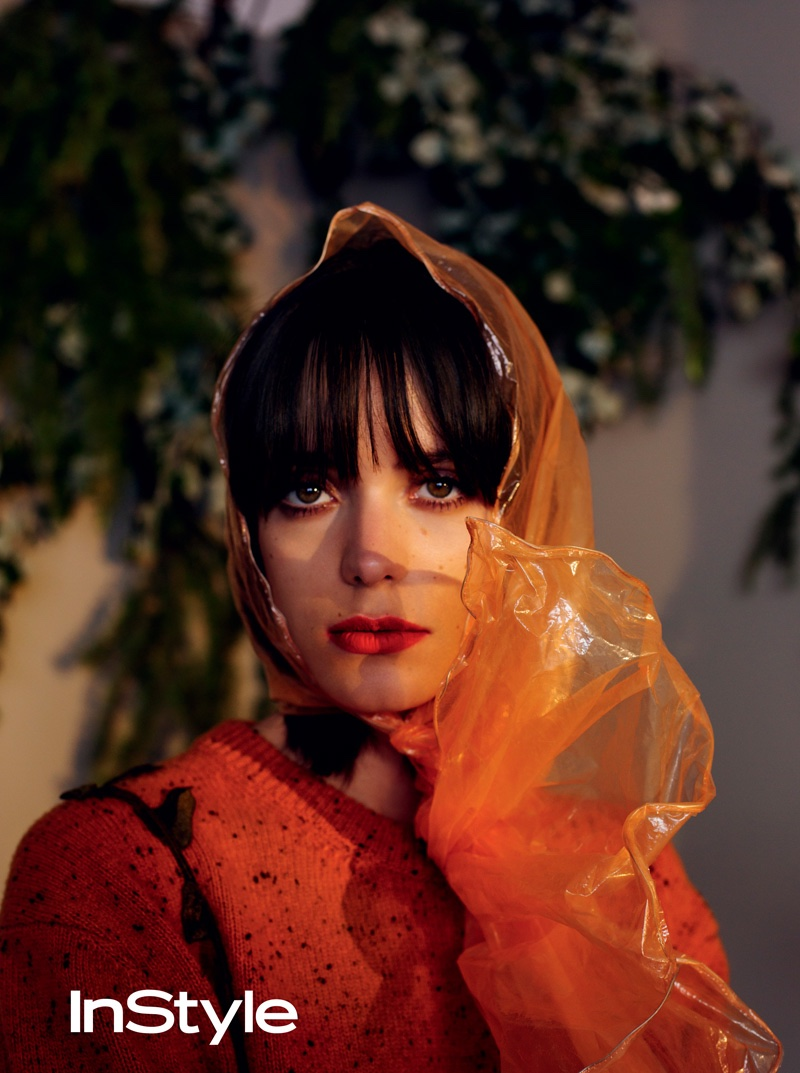 Stacy Martin serves retro beauty vibes with transparent scarf, blunt bangs and red lipstick