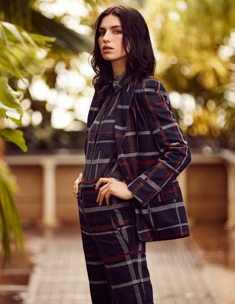 The model embraces a checkered print for fall