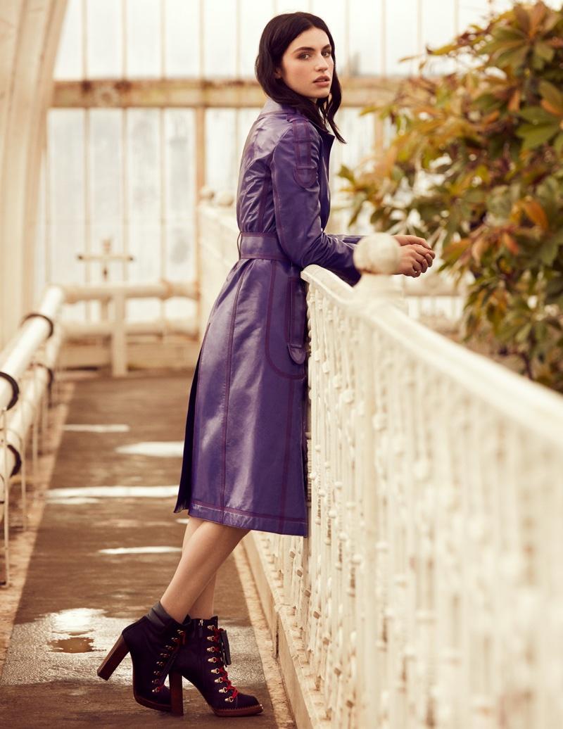 A purple coat makes a bold, jewel toned statement