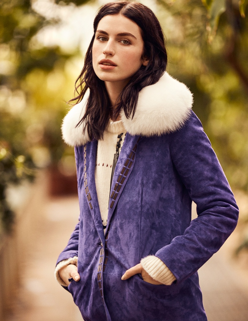 The model poses in fur trimmed jacket from Tod's
