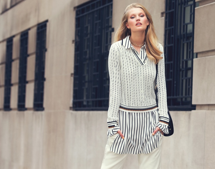Toni Garrn embraces print in Frame sweater, McQ Alexander McQueen dress, Elizabeth and James pants and A.P.C. bag