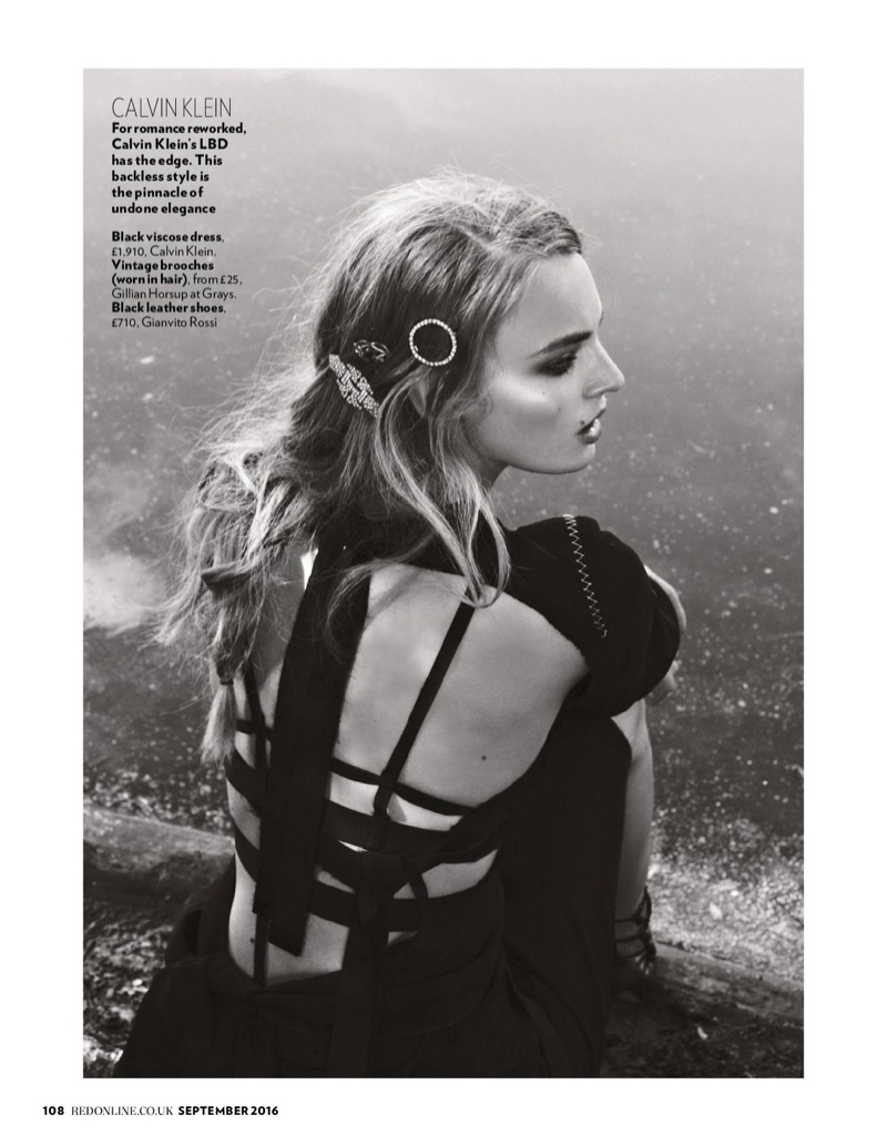 Ymre Stiekema wears brooches in her hair with Calvin Klein dress and Gianvito Rossi boots
