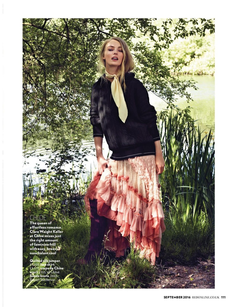 The model layers up in Chloe sweater, multi-colored skirt and suede boots