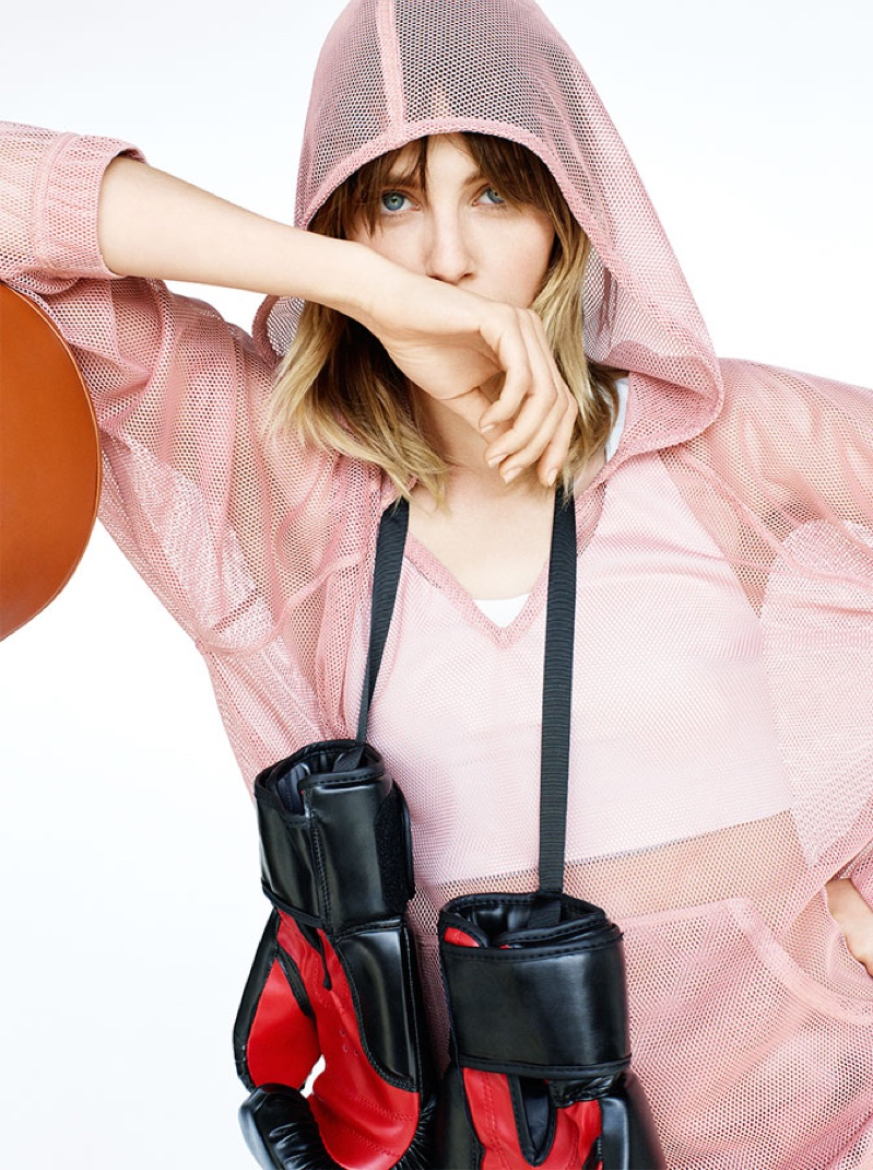 Edie Campbell models mesh hooded sweatshirt from Zara with boxing gloves