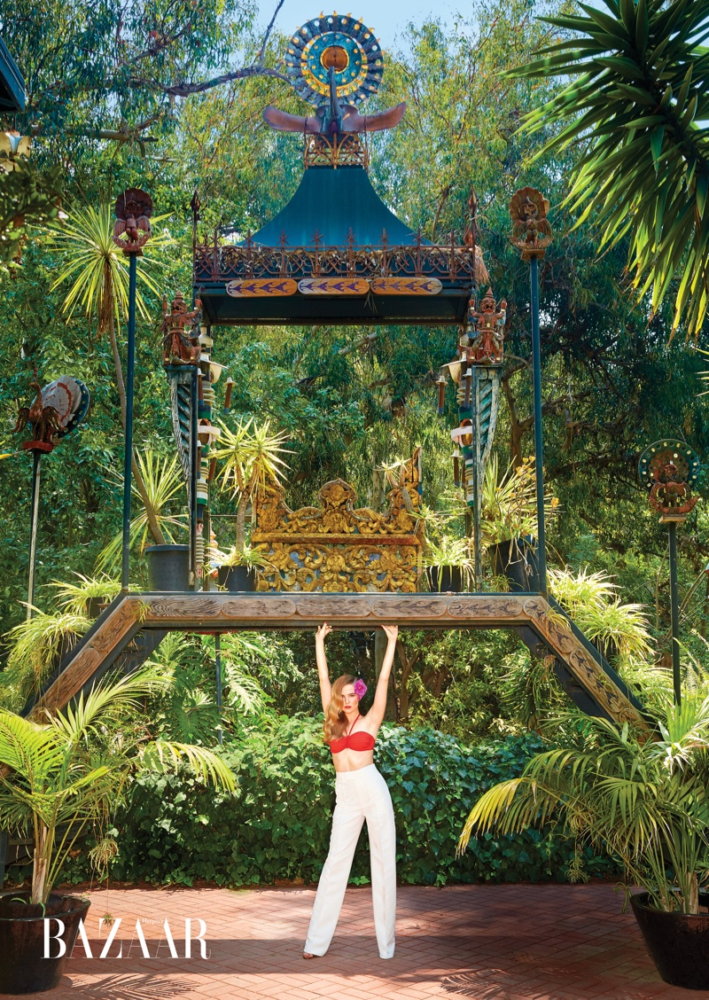 Zoey Deutch serves tropical vibes in Hermes bikini top and Bally high-waist pants