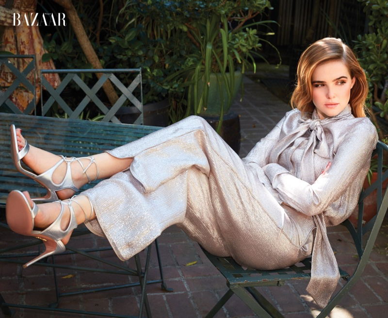 Zoey Deutch lounges in Tory Burch tunic and pants with metallic Aquazzura sandals